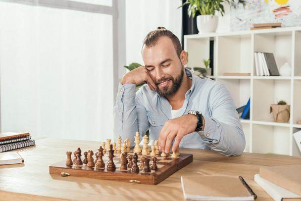 man playing chess with himself - Photo, Image