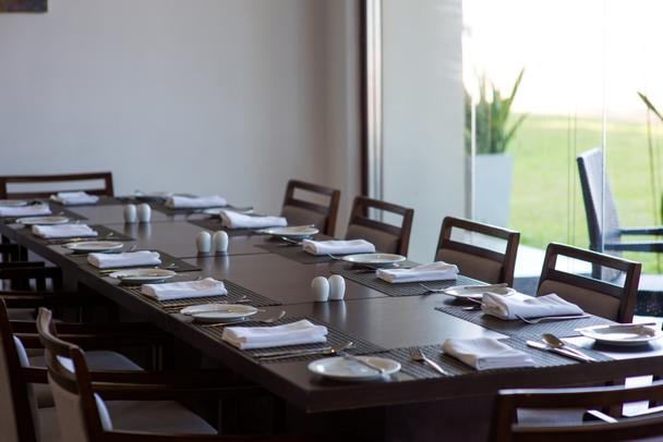 served table in empty restaurant - Photo, Image
