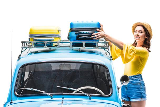 woman putting luggage on car roof - Photo, Image
