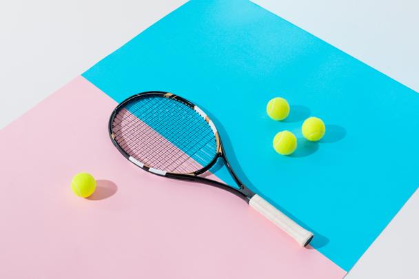 tennis racket and yellow balls on blue and pink papers - Photo, Image
