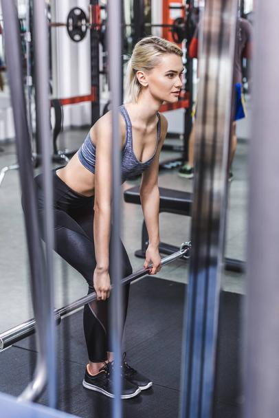 attractive young sportive woman doing deadlift at gym - Photo, Image