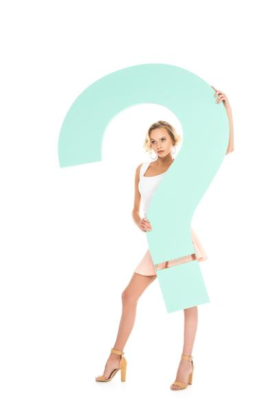young woman with big question mark in hands looking at camera isolated on white - Photo, Image