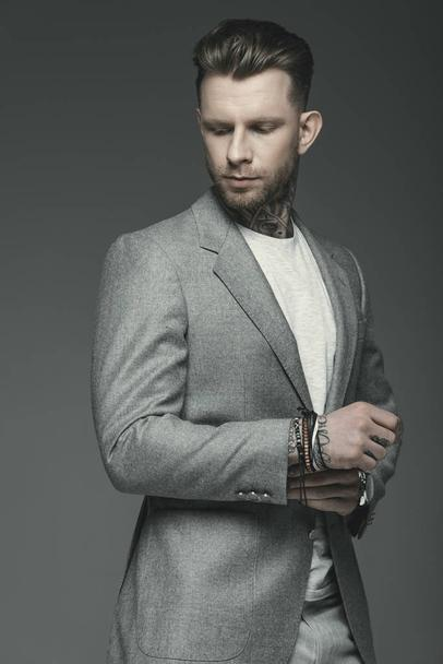 handsome executive businessman in suit, isolated on grey - Photo, Image