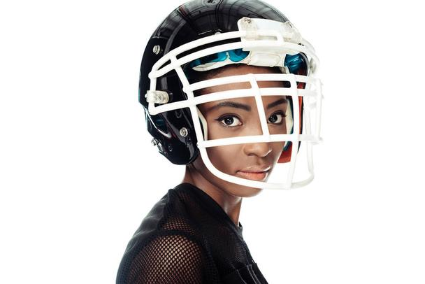 close-up portrait of female american football player in helmet isolated on white - Photo, Image