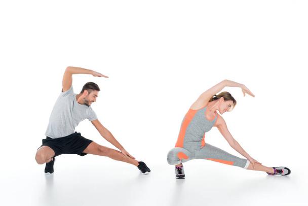 sportive couple warming up before training isolated on white - Photo, Image
