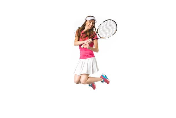 beautiful attractive girl playing tennis and jumping isolated on white - Photo, Image