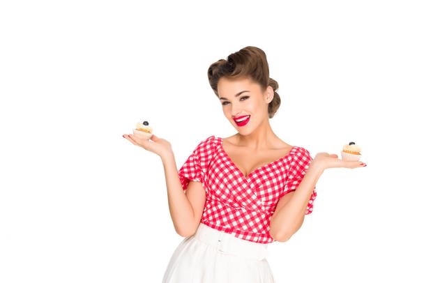portrait of beautiful woman in pin up clothing with cupcakes isolated on white - Photo, Image