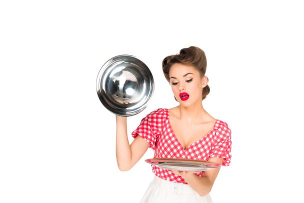 portrait of beautiful young woman in retro clothing with empty serving tray in hands isolated on white - Photo, Image