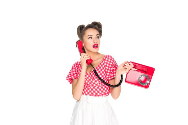 portrait of pin up woman talking on old telephone isolated on white - Photo, Image