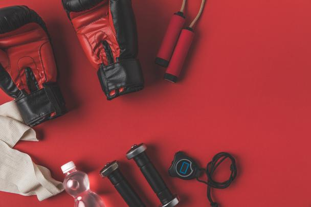 flat lay composition of boxer training equipment on red tabletop - Photo, Image