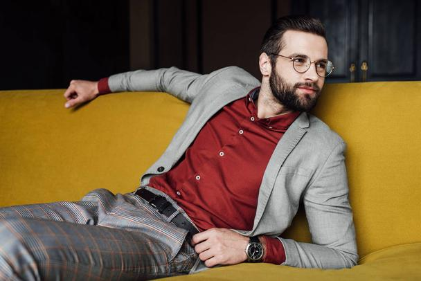 bearded elegant man relaxing on couch - Photo, Image
