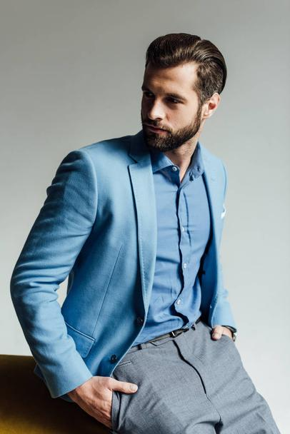 fashionable handsome man in blue trendy suit  - Photo, Image