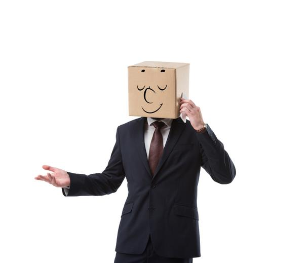 relaxed businessman with cardboard box on head talking on smartphone isolated on white - Photo, Image