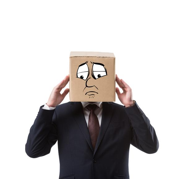 businessman with cardboard box on head having headache isolated on white  - Photo, Image
