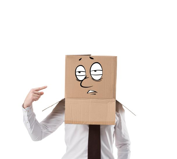 overworked businessman pointing on cardboard box on his head isolated on white - Photo, Image