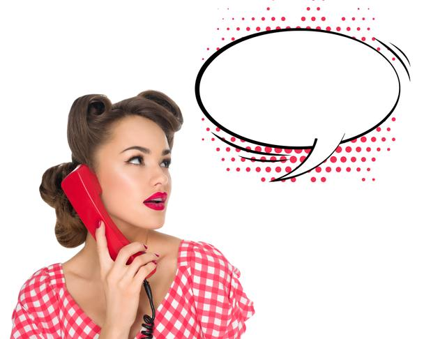 portrait of pin up woman talking on old telephone with empty speech bubble isolated on white - Photo, Image