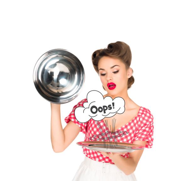 beautiful young woman in retro clothing with oops comic style symbol on serving tray in hands isolated on white - Photo, Image