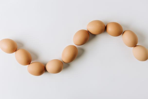 brown eggs laying on white background - Photo, Image