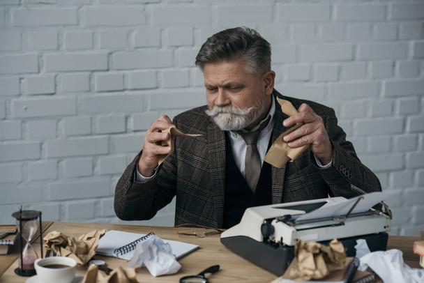 depressed senior writer tearning his manuscript - Photo, Image