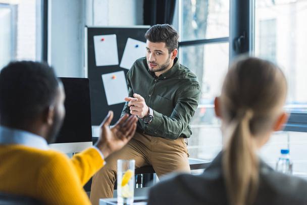 multicultural businessmen talking in office during brainstorm - Photo, Image