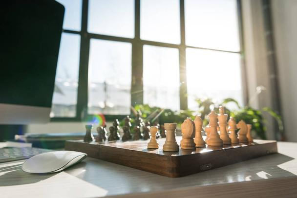 traditional chess board on workplace against sunshine - Photo, Image