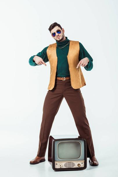 handsome retro styled man pointing on television on white - Photo, Image