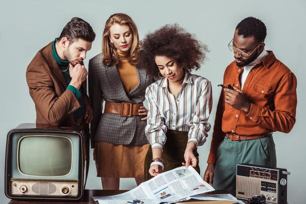 multicultural retro styled journalists in newsroom isolated on grey - Photo, Image