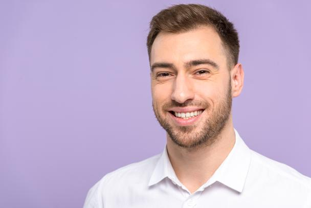 Handsome man smiling isolated on violet - Photo, Image