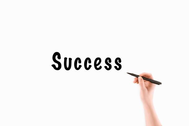bijgesneden afbeelding van vrouw schrijven succes inscriptie geïsoleerd op wit - Foto, afbeelding