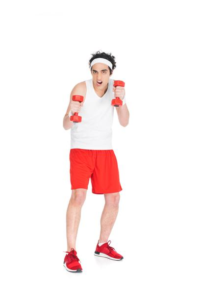 Skinny man in sporstwear exercising with dumbbells isolated on white - Photo, Image