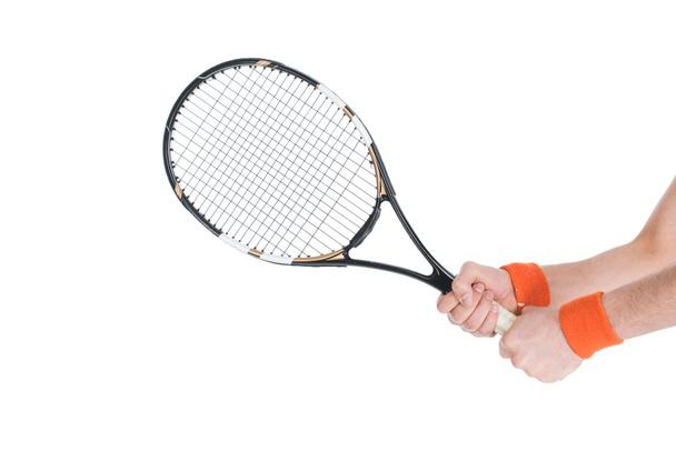 Cropped image of tennis player holding racket isolated on white - Photo, Image