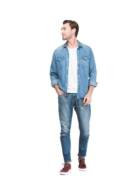 young smiling man in jeans, isolated on white - Photo, Image