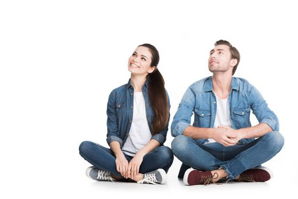 couple sitting in denim clothes, isolated on white - Photo, Image