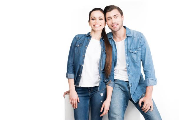 young hugging couple looking at camera, isolated on white - Photo, Image