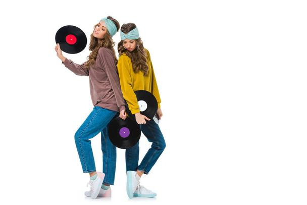 attractive retro styled young twins with LP vinyls isolated on white - Photo, Image