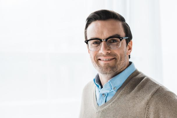 Smiling attractive man wearing browline glasses - Photo, Image