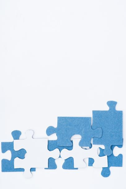 top view of white and blue puzzles isolated on white, business concept - Photo, Image