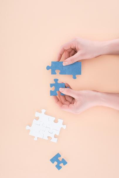 cropped image of businesswoman assembling puzzles isolated on beige, business concept - Photo, Image
