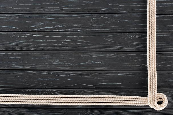 top view of arranged white marine ropes on dark wooden tabletop - Photo, Image