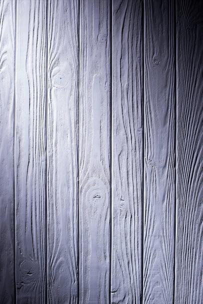 Wooden planks painted in violet background - Photo, Image