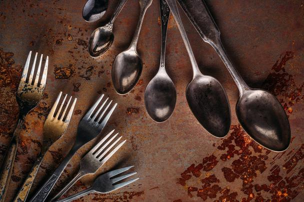 Vintage spoons and forks on rusted table - Photo, Image