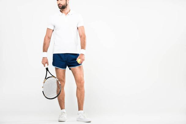 bearded tennis player in retro sunglasses standing with racket and ball, isolated on white   - Photo, Image
