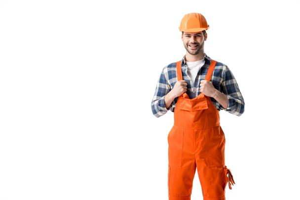 Smiling repairman in orange overall and hard hat isolated on white - Photo, Image