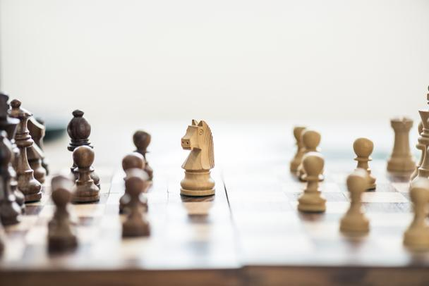 close-up view of wooden chess figures on chess board, selective focus - Photo, Image