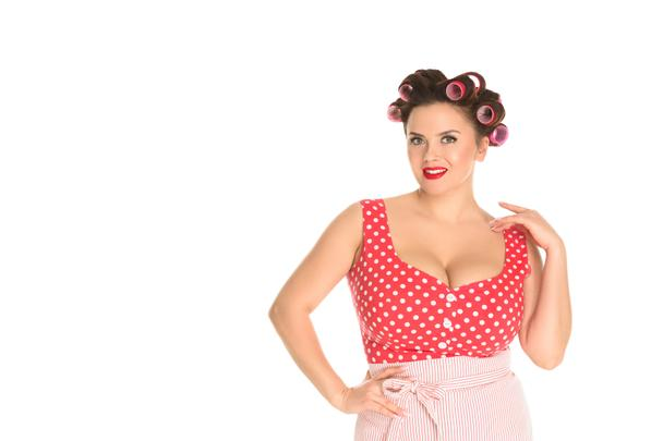 attractive plus size housewife in red dress with curlers in hair isolated on white - Photo, Image