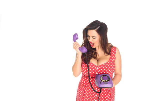 angry plus size woman shouting at vintage rotary phone isolated on white - Photo, Image