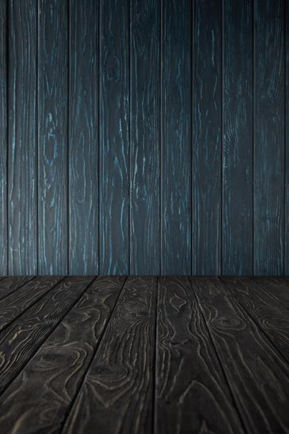 grey wooden table and dark blue wooden wall - Photo, Image