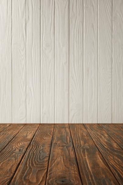 dark brown striped tabletop and white wooden wall - Photo, Image