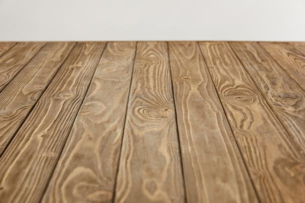 empty wooden tabletop isolated on grey - Photo, Image