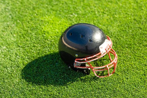 high angle view of american football helmet lying on grass - Photo, Image
